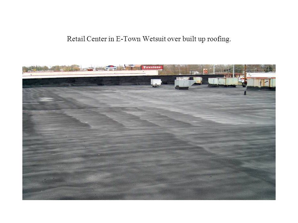 Retail Center in E-Town Wetsuit over built up roofing.