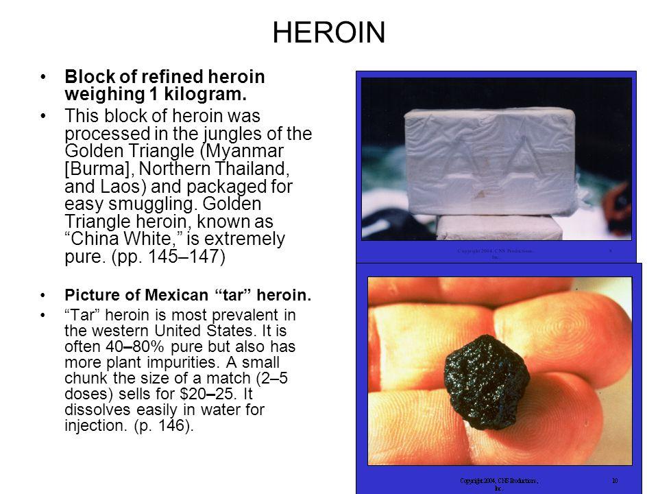 HEROIN Block of refined heroin weighing 1 kilogram.