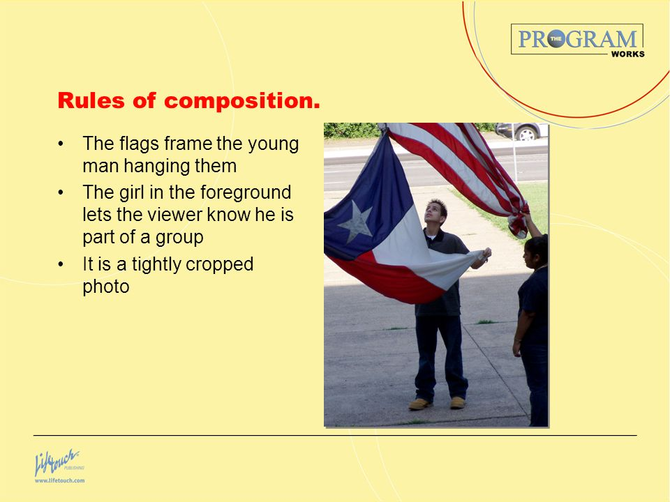 Rules of composition. The flags frame the young man hanging them