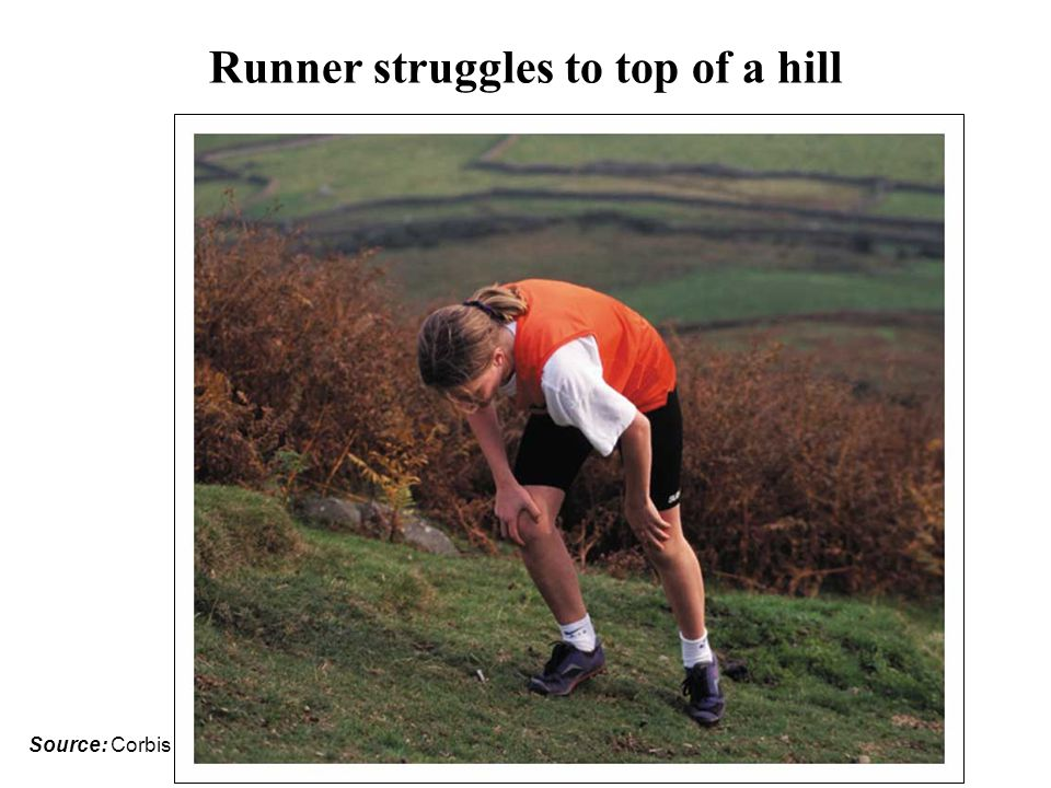 Runner struggles to top of a hill
