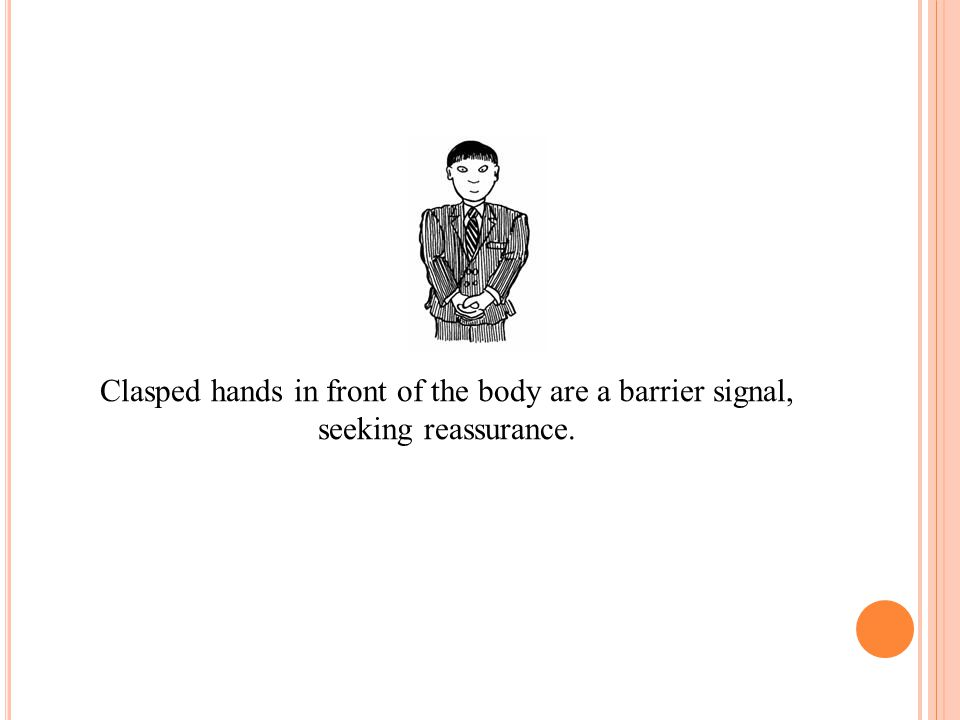 Clasped hands in front of the body are a barrier signal,