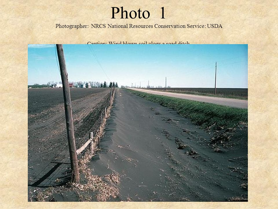 Photo 1 Photographer: NRCS National Resources Conservation Service: USDA Caption: Wind blown soil clogs a road ditch.