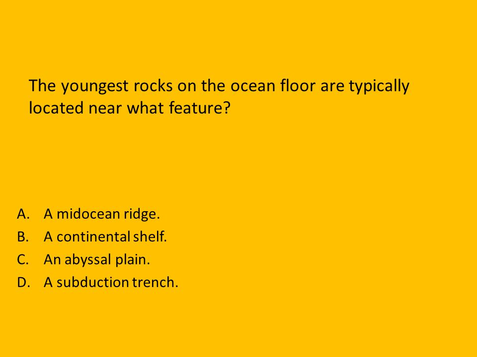The youngest rocks on the ocean floor are typically located near what feature