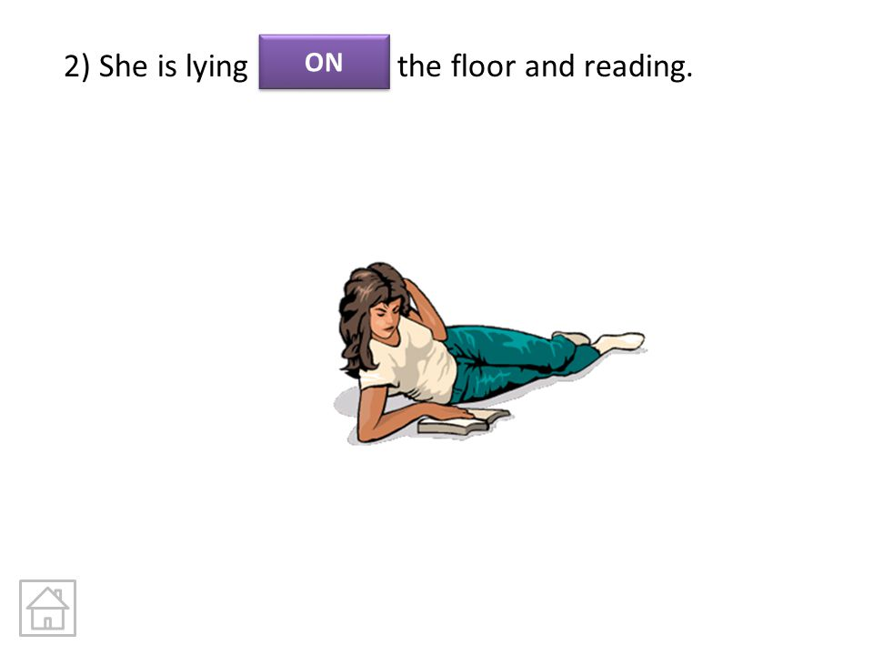 2) She is lying the floor and reading.