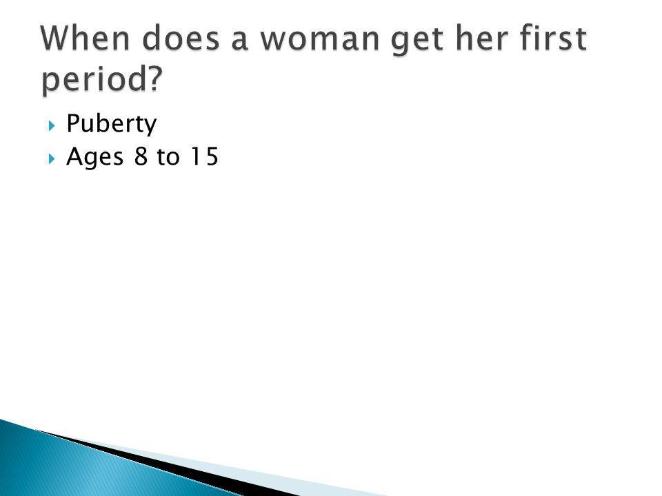When does a woman get her first period