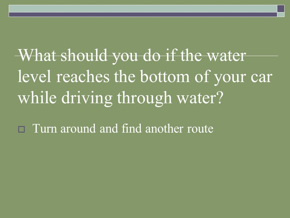 What should you do if the water level reaches the bottom of your car while driving through water