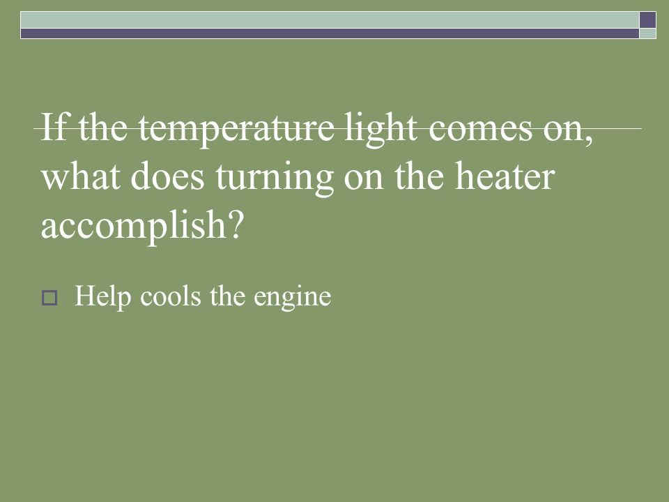 If the temperature light comes on, what does turning on the heater accomplish