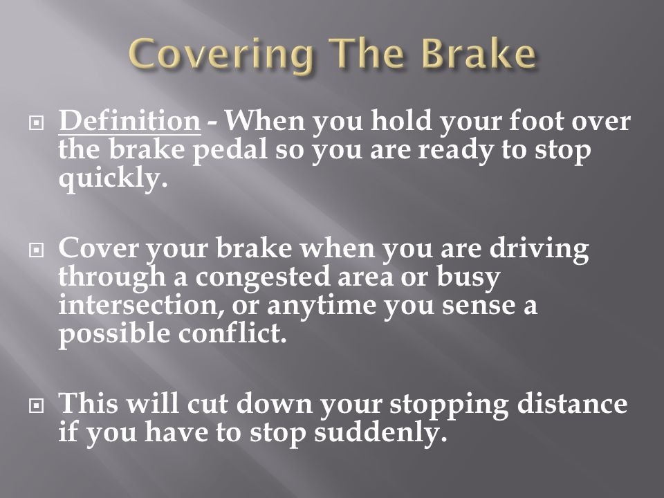 Covering The Brake Definition - When you hold your foot over the brake pedal so you are ready to stop quickly.