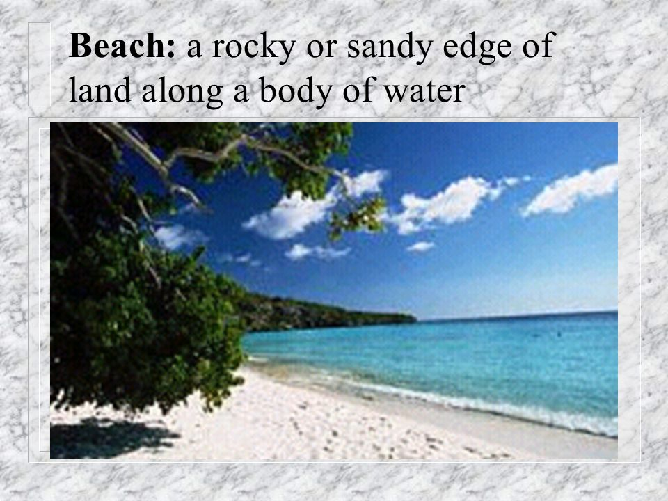 Beach: a rocky or sandy edge of land along a body of water