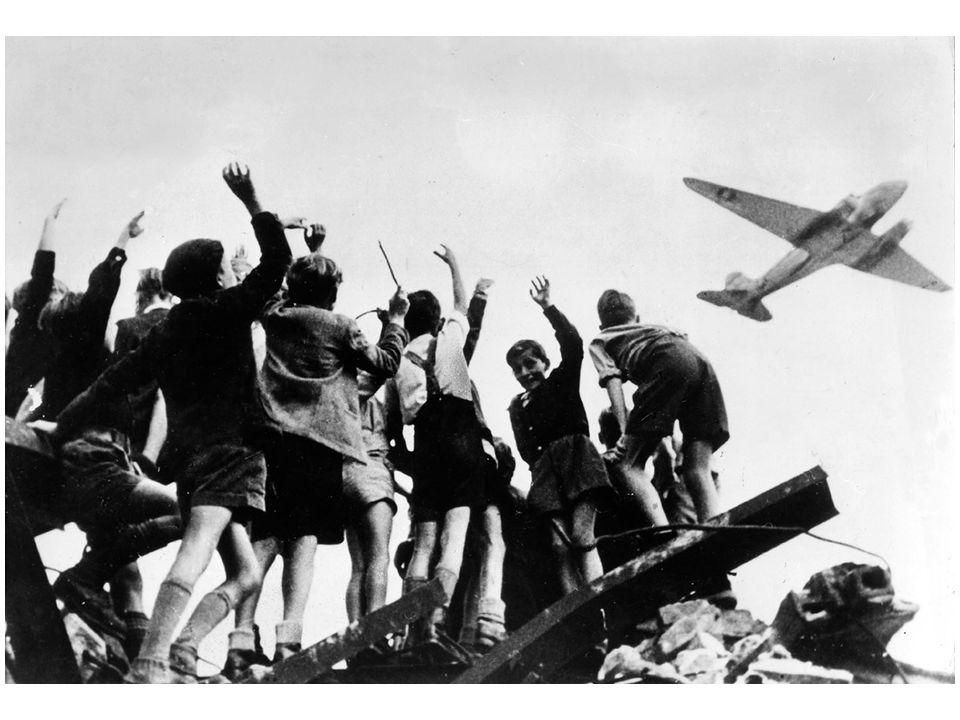 fig23_05.jpg Page 900: Children in Berlin celebrate the arrival of a plane bringing supplies to counter the Soviet blockade of the city in 1948.