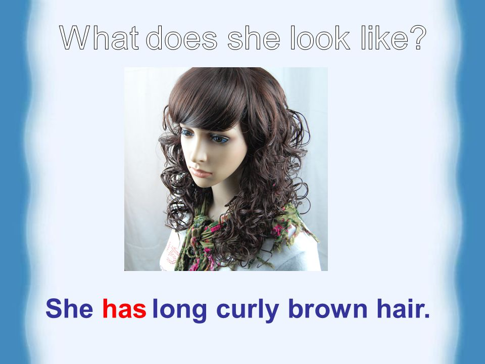 She has long curly brown hair.