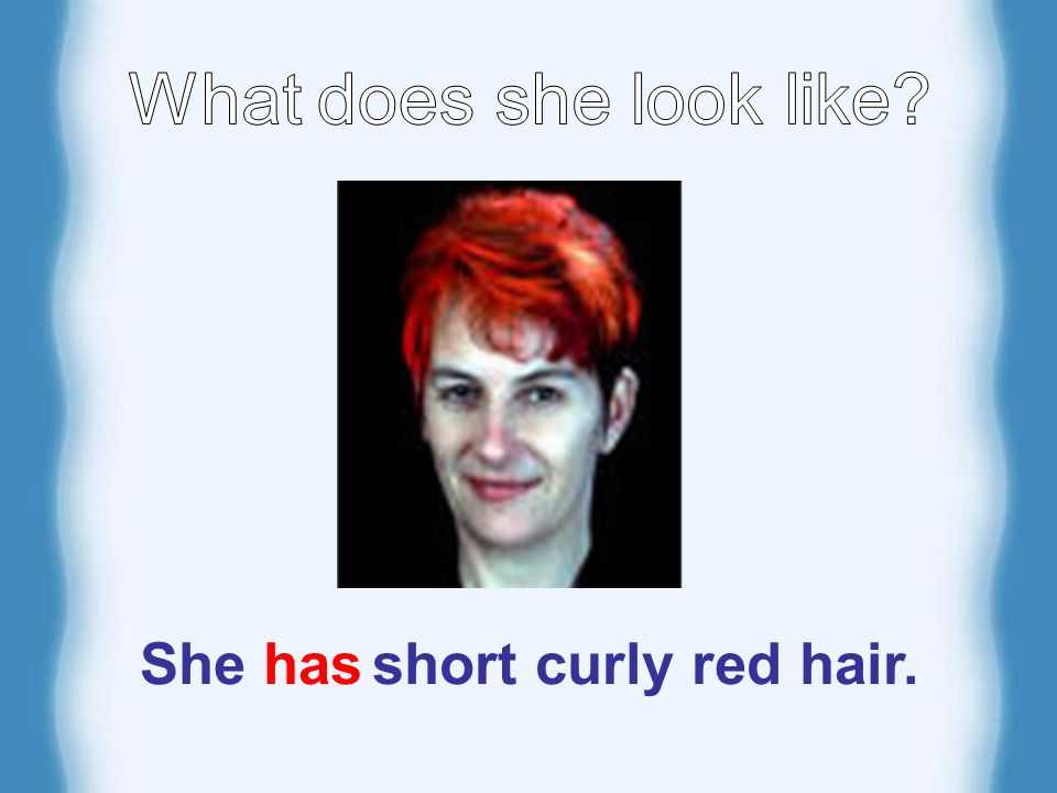 She has short curly red hair.