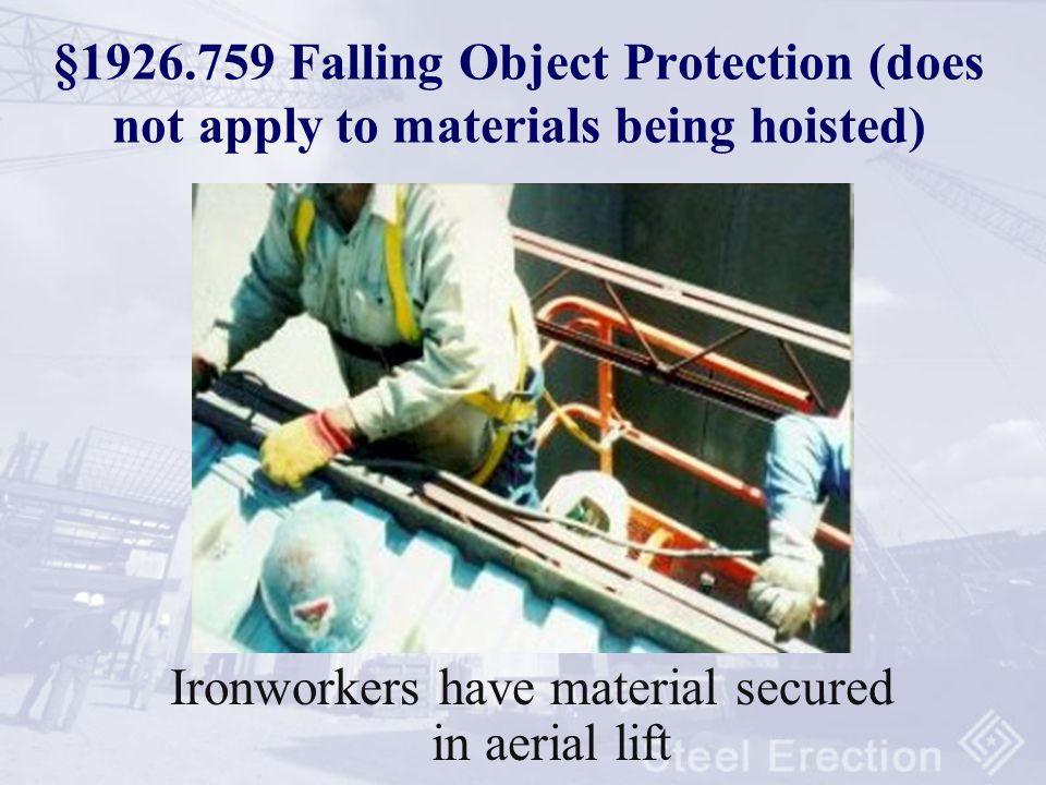 Ironworkers have material secured in aerial lift