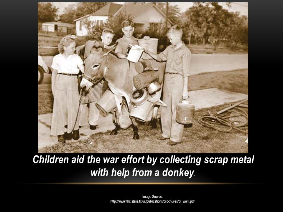 Children aid the war effort by collecting scrap metal with help from a donkey.