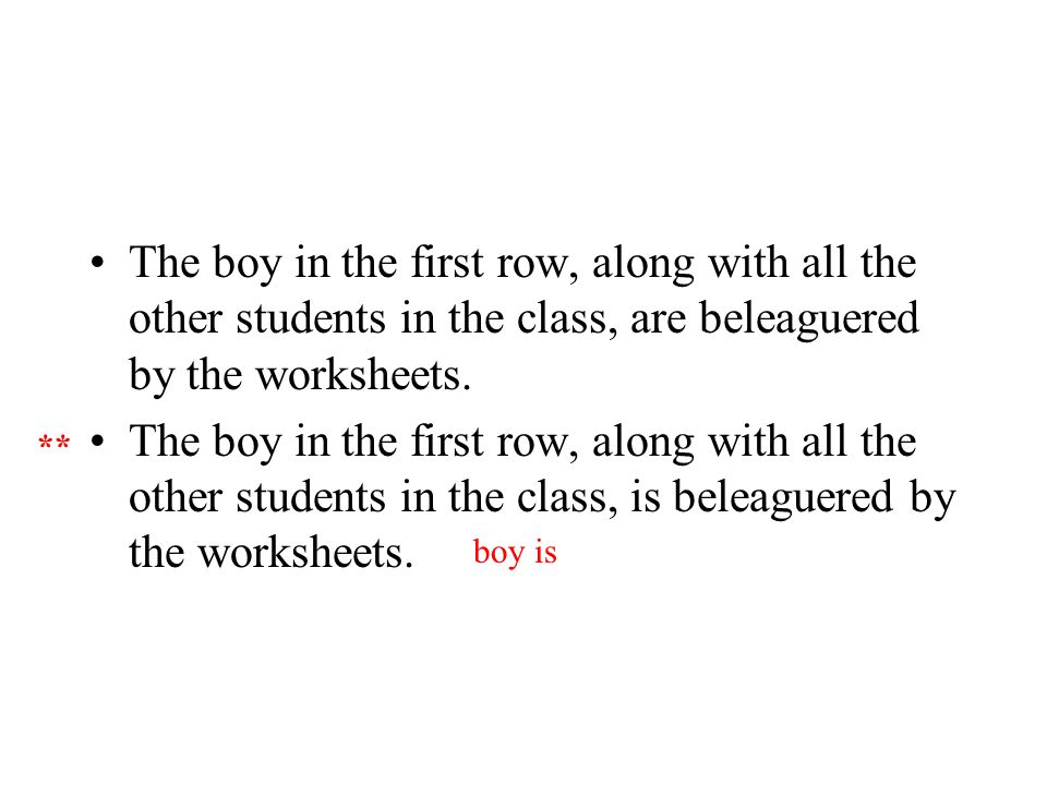 The boy in the first row, along with all the other students in the class, are beleaguered by the worksheets.