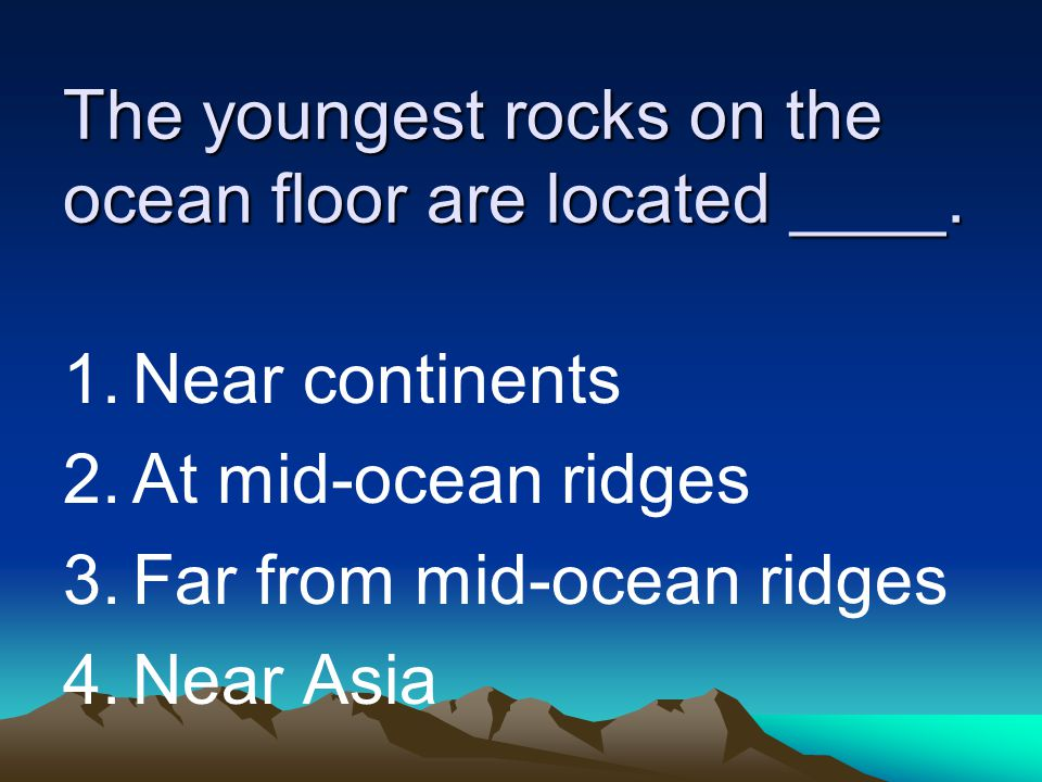 The youngest rocks on the ocean floor are located ____.