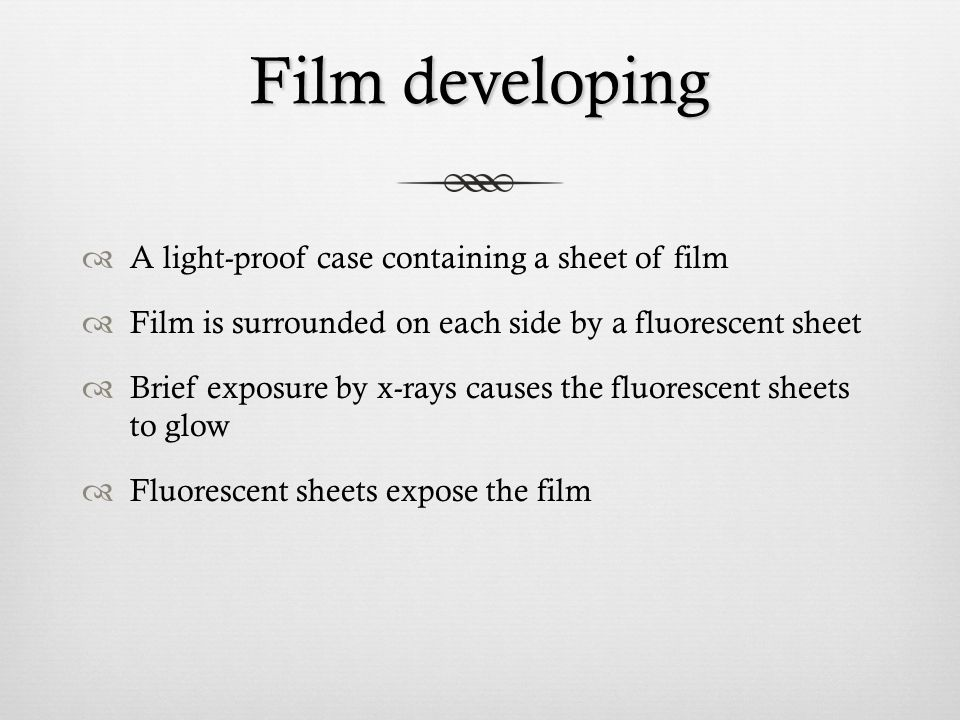 Film developing A light-proof case containing a sheet of film