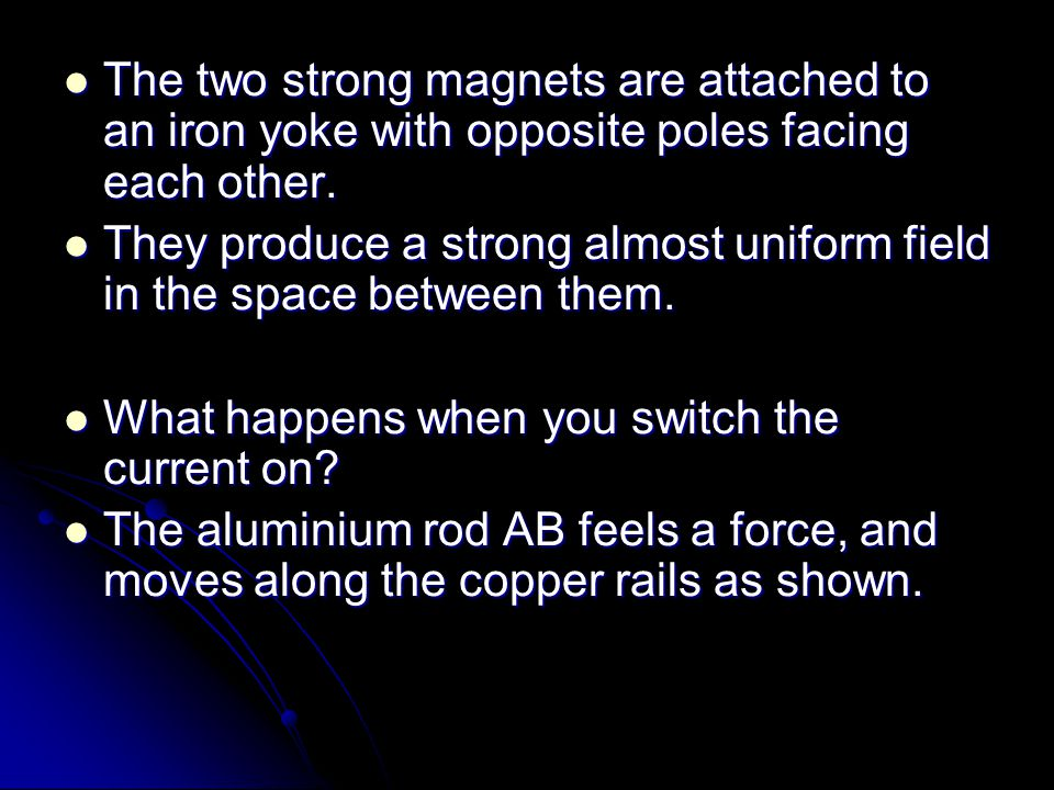 The two strong magnets are attached to an iron yoke with opposite poles facing each other.