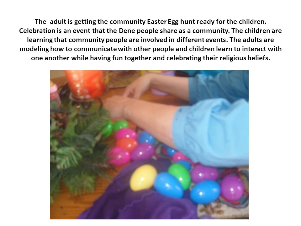 The adult is getting the community Easter Egg hunt ready for the children.