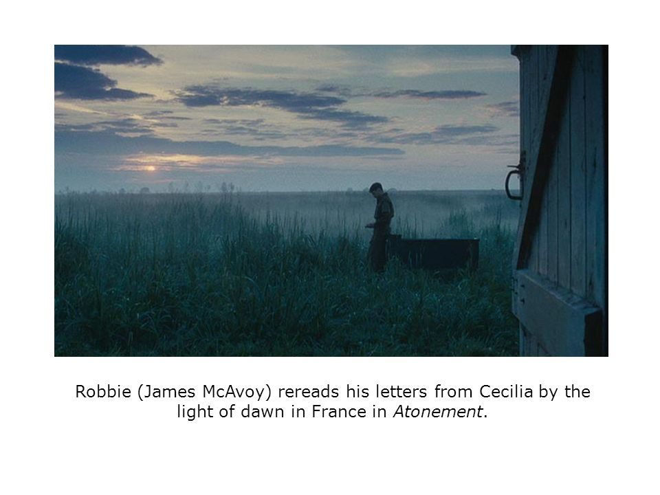 Robbie (James McAvoy) rereads his letters from Cecilia by the light of dawn in France in Atonement.
