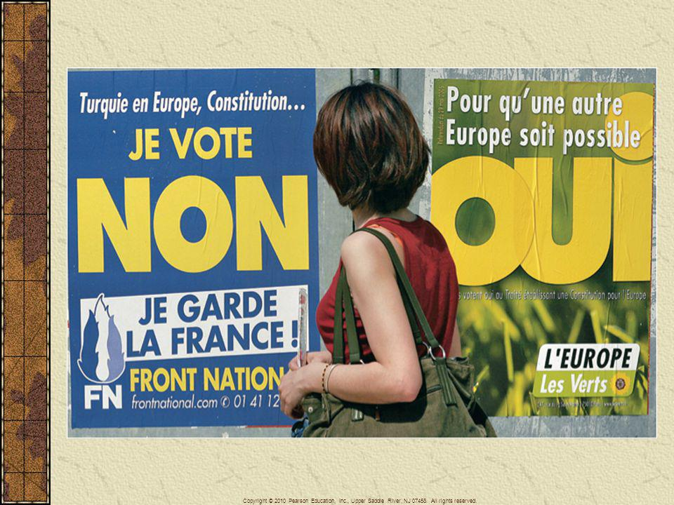 A woman stands between a yes and a no campaign poster in reference to France's referendum on the EU constitution in a street of Rennes, western France, Friday May 27, 2005, two days before the vote.