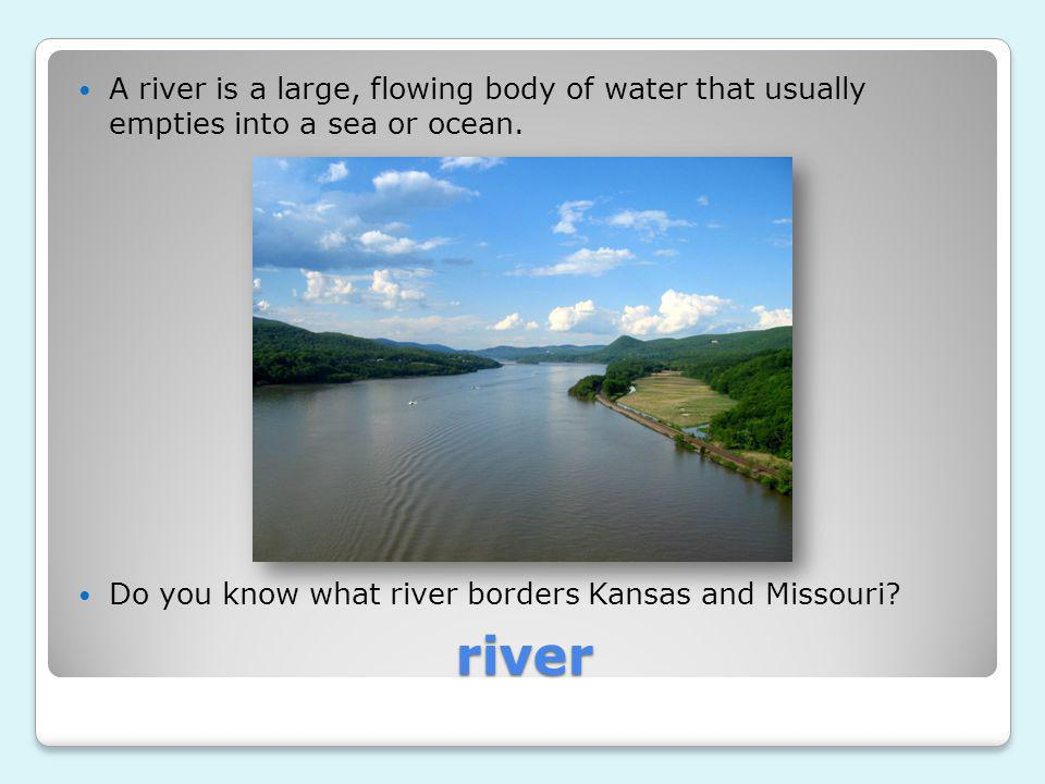 A river is a large, flowing body of water that usually empties into a sea or ocean.