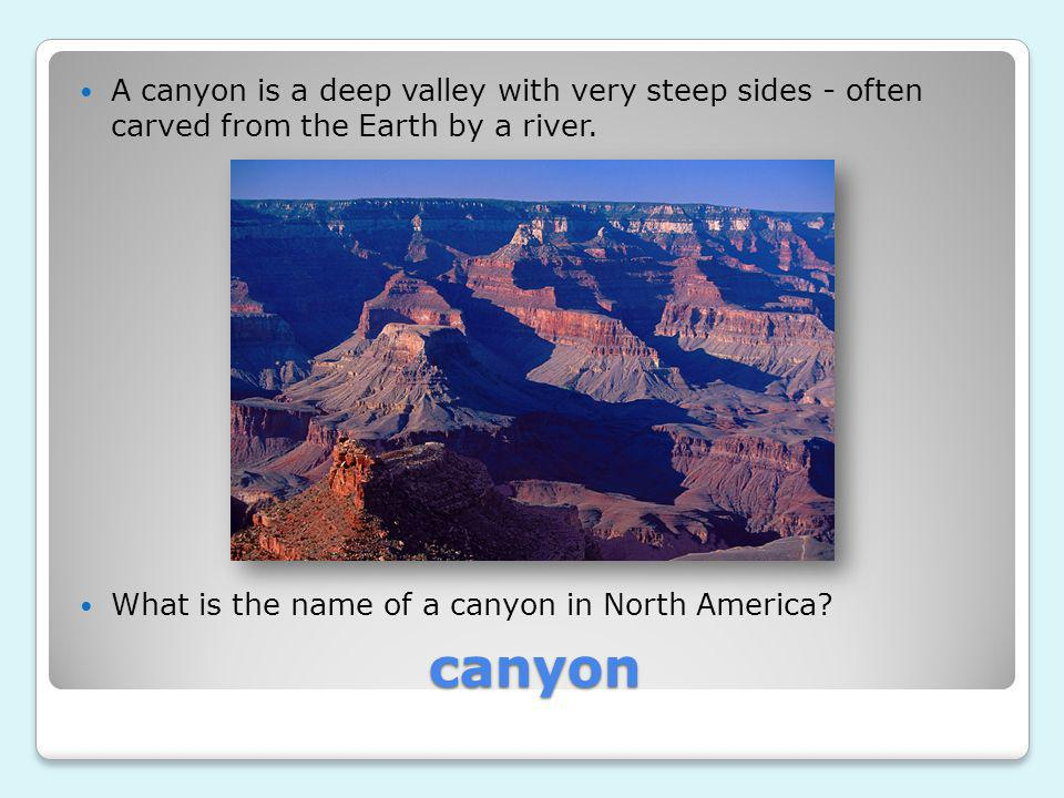 A canyon is a deep valley with very steep sides - often carved from the Earth by a river.