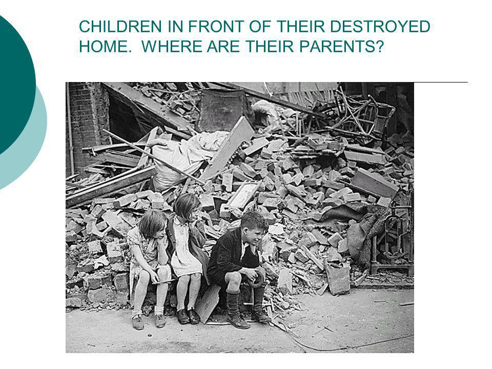 CHILDREN IN FRONT OF THEIR DESTROYED HOME. WHERE ARE THEIR PARENTS
