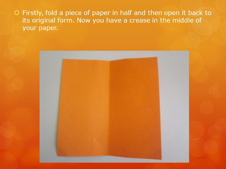 Firstly, fold a piece of paper in half and then open it back to its original form.