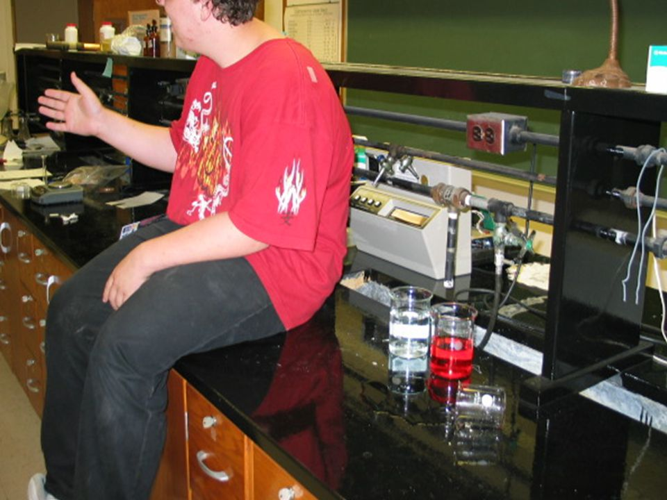 Never sit on lab tables. Crystals or liquids left on the table can cause serious harm to you.