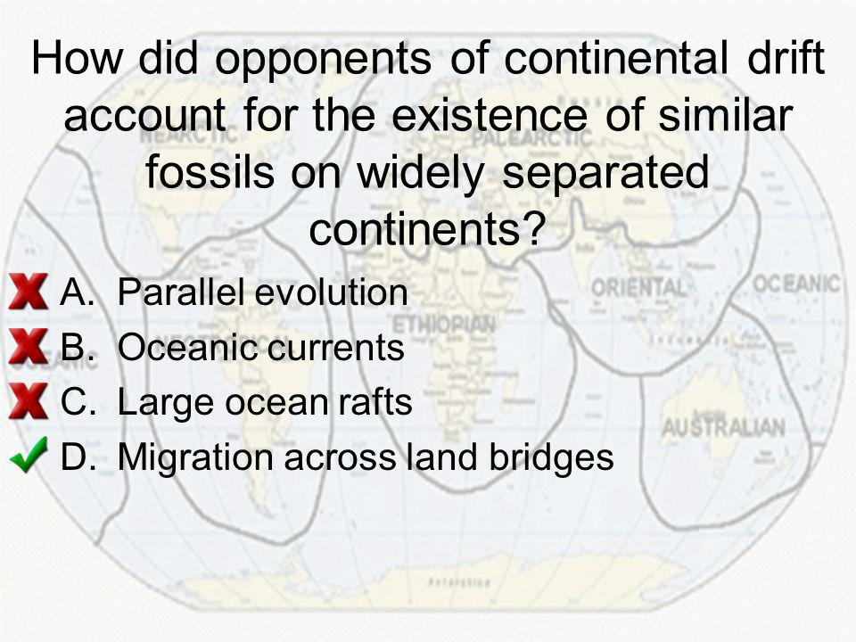 How did opponents of continental drift account for the existence of similar fossils on widely separated continents