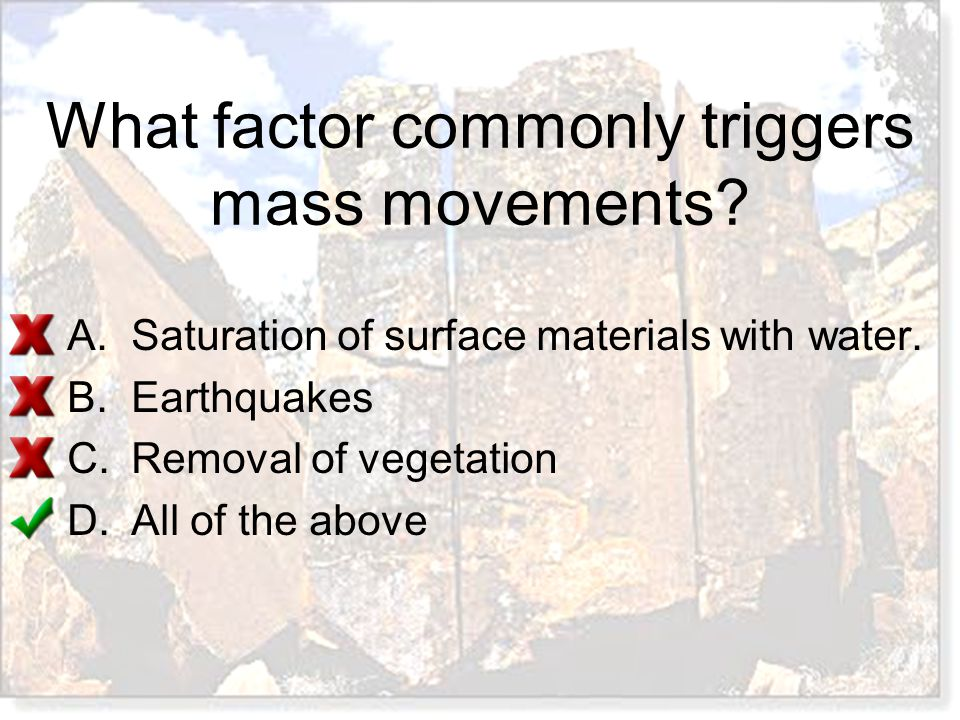 What factor commonly triggers mass movements