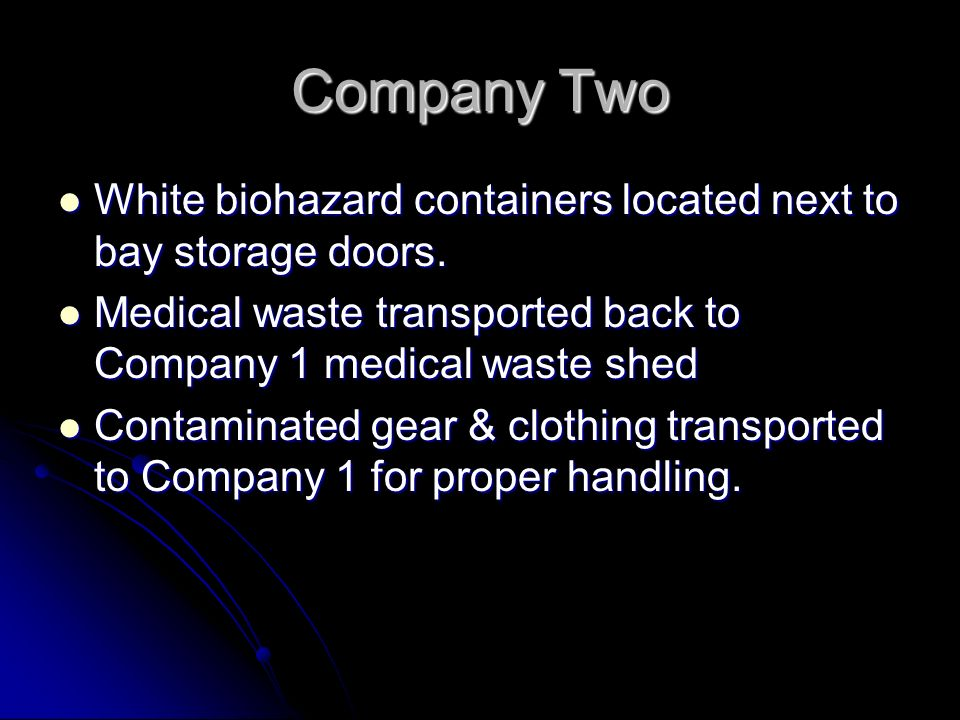 Company TwoWhite biohazard containers located next to bay storage doors. Medical waste transported back to Company 1 medical waste shed.