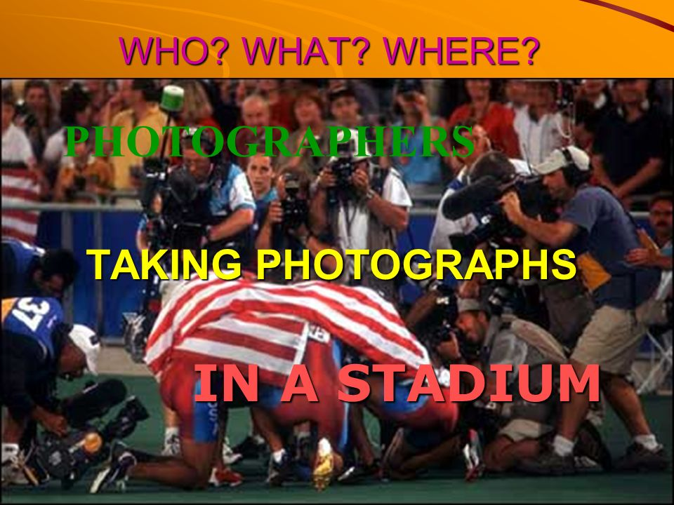 WHO WHAT WHERE PHOTOGRAPHERS TAKING PHOTOGRAPHS IN A STADIUM