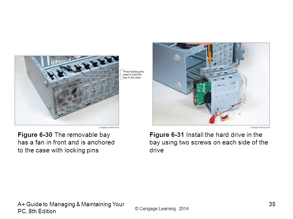 Figure 6-30 The removable bay has a fan in front and is anchored to the case with locking pins