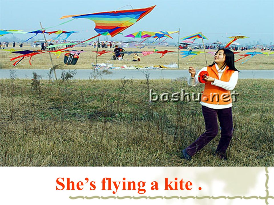 She's flying a kite .