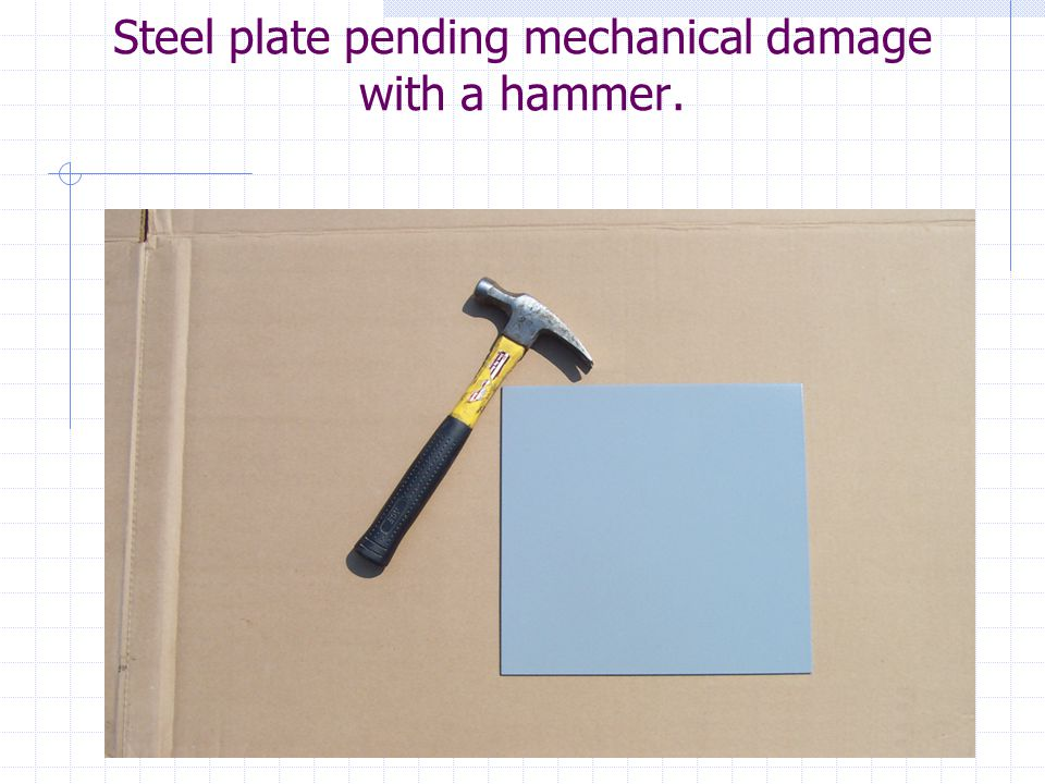 Steel plate pending mechanical damage with a hammer.