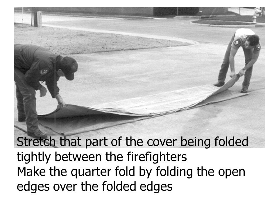 Stretch that part of the cover being folded tightly between the firefighters