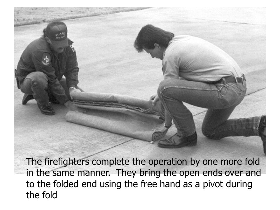 The firefighters complete the operation by one more fold in the same manner.