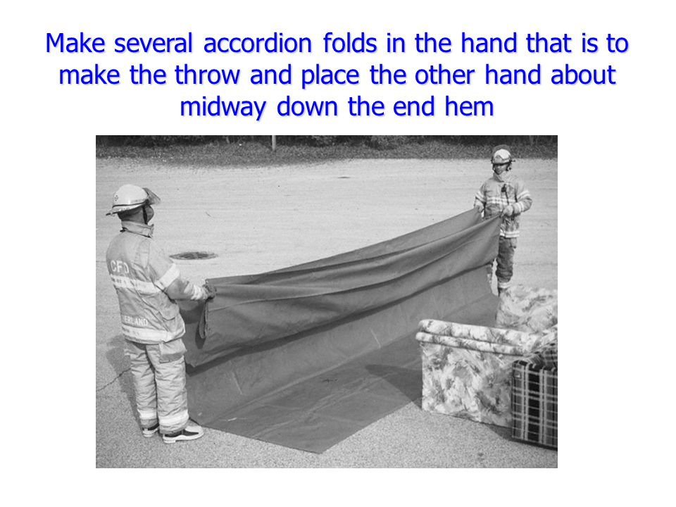 Make several accordion folds in the hand that is to make the throw and place the other hand about midway down the end hem