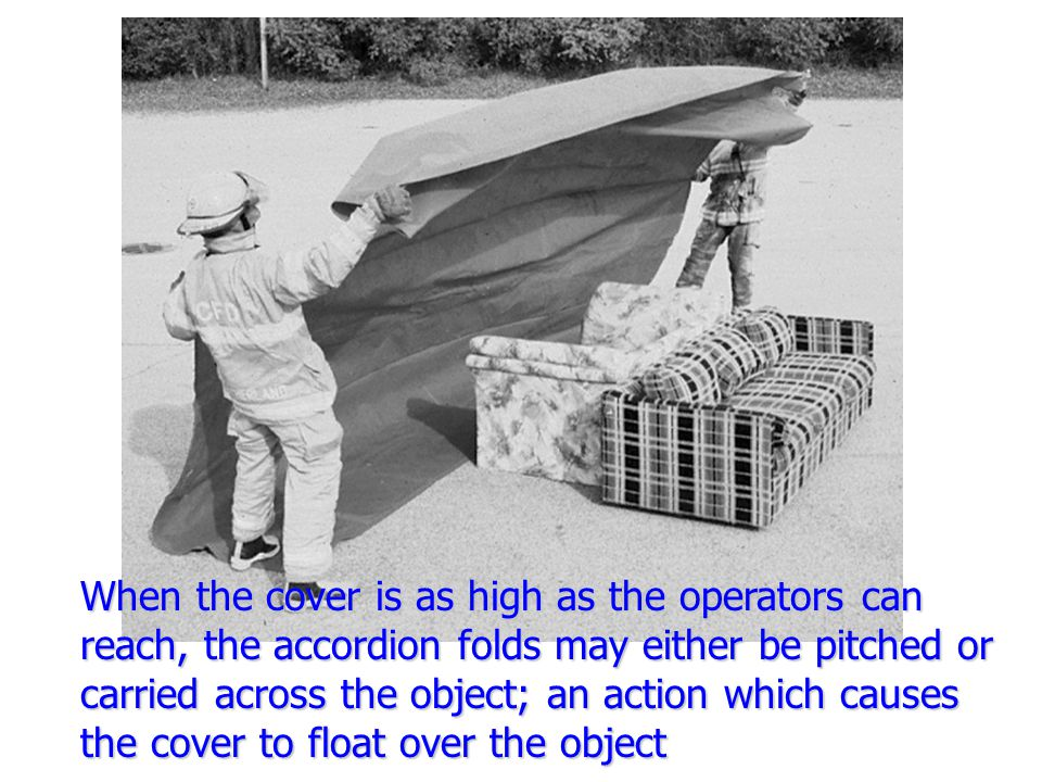 When the cover is as high as the operators can reach, the accordion folds may either be pitched or carried across the object; an action which causes the cover to float over the object