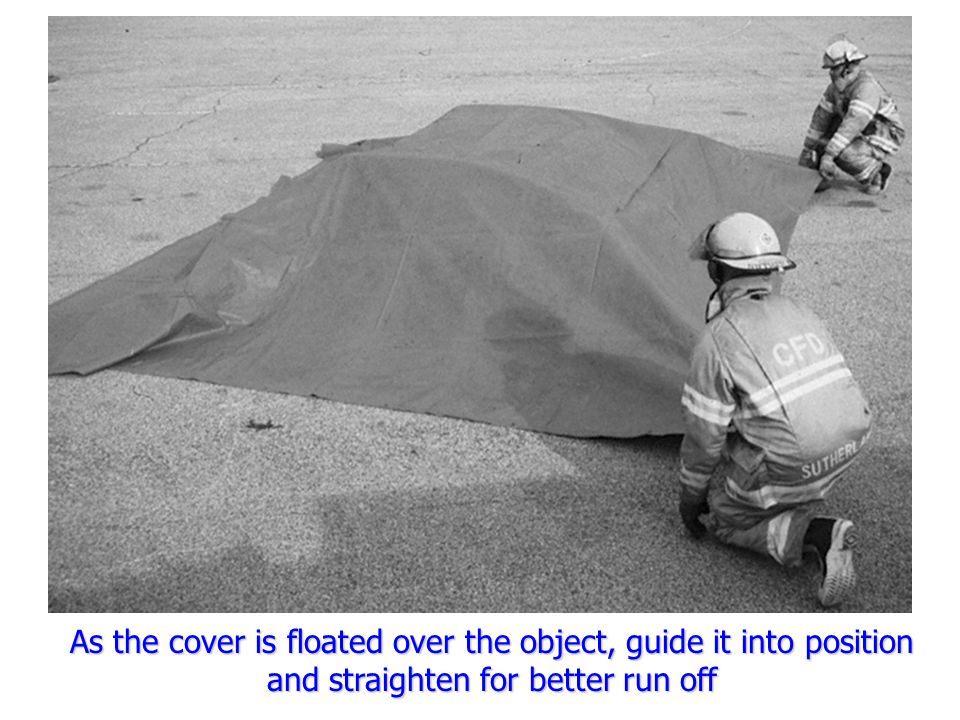 As the cover is floated over the object, guide it into position and straighten for better run off