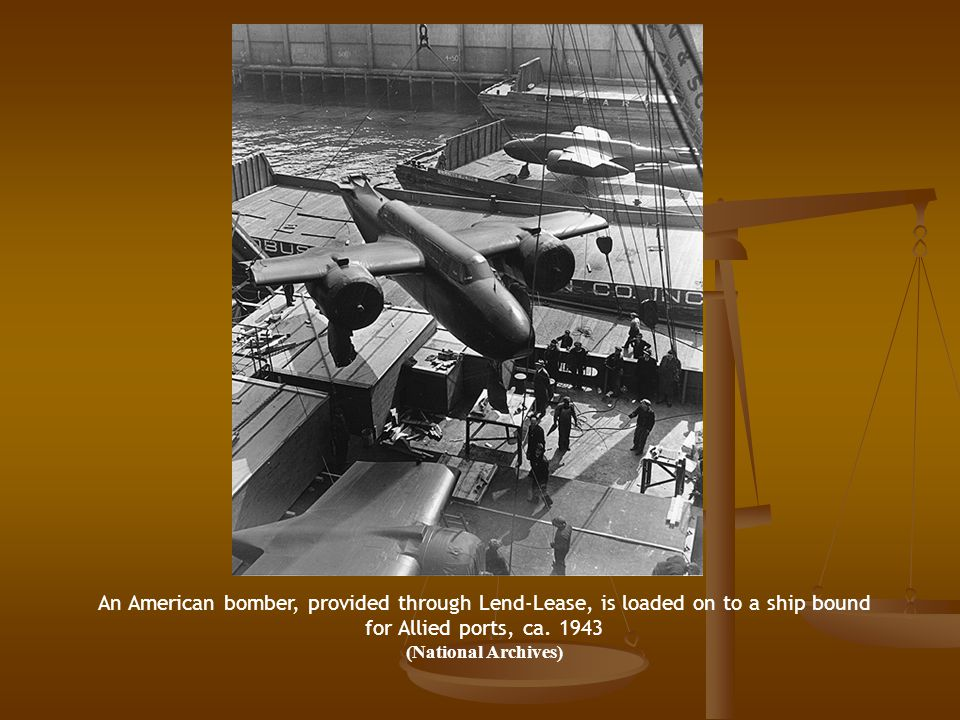 An American bomber, provided through Lend-Lease, is loaded on to a ship bound for Allied ports, ca.