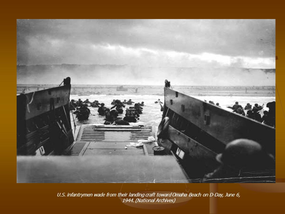 U.S. infantrymen wade from their landing craft toward Omaha Beach on D-Day, June 6, 1944.