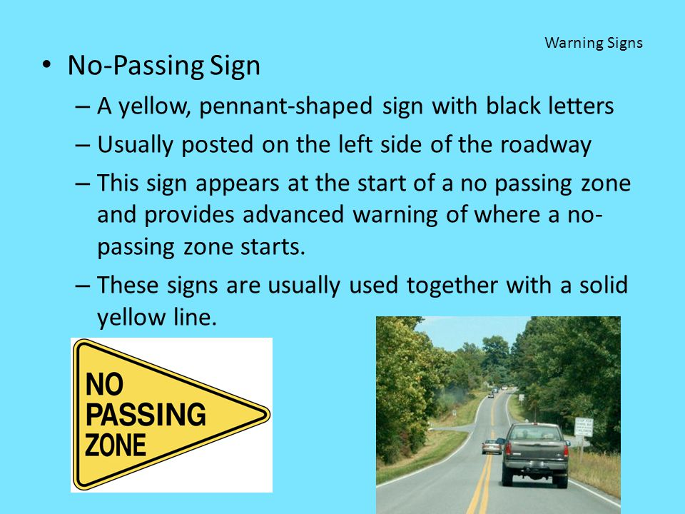 No-Passing Sign A yellow, pennant-shaped sign with black letters