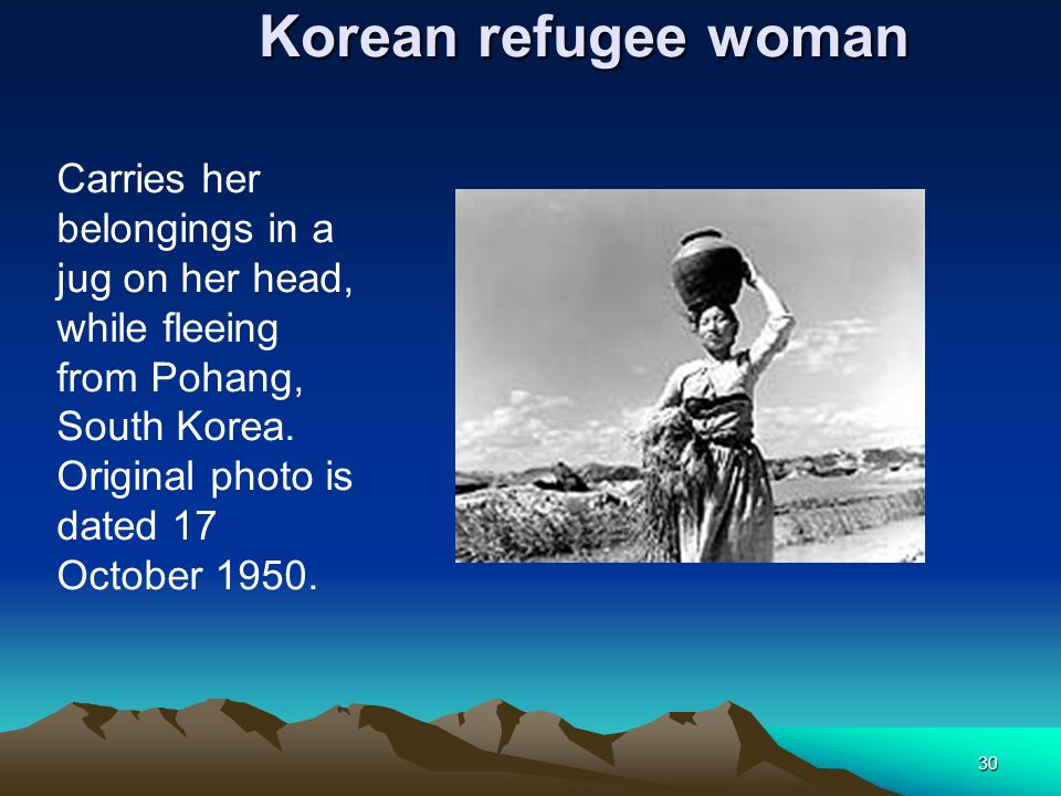 Korean refugee woman Carries her belongings in a jug on her head, while fleeing from Pohang, South Korea.