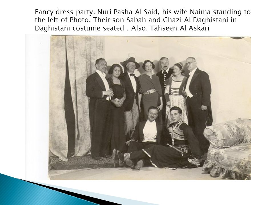 Fancy dress party. Nuri Pasha Al Said, his wife Naima standing to the left of Photo.