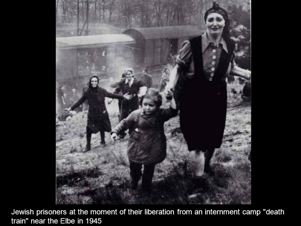 Jewish prisoners at the moment of their liberation from an internment camp death train near the Elbe in 1945