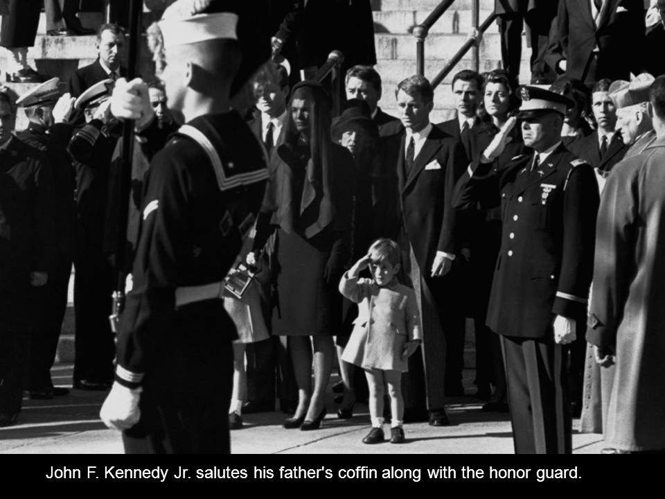 John F. Kennedy Jr. salutes his father s coffin along with the honor guard.