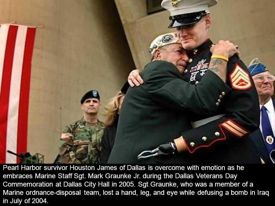 Pearl Harbor survivor Houston James of Dallas is overcome with emotion as he embraces Marine Staff Sgt.